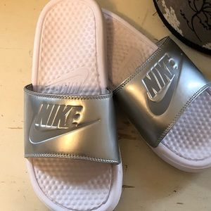 BNWOT women's Nike slides silver and white size 7